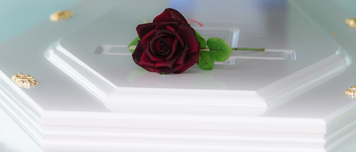 rose on casket